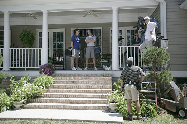 Peyton and little brother Eli talk while filming a DirecTV commercial. Though Peyton's stats are undeniably better, Eli has one more Super Bowl championship than his older brother.