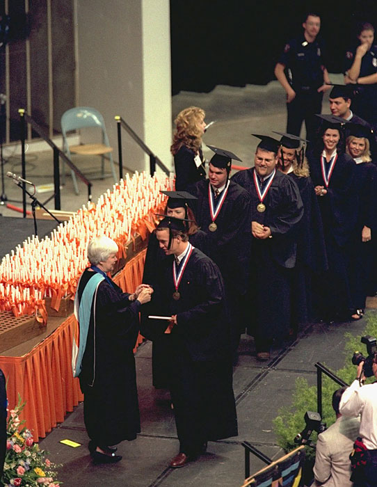 Manning receives his diploma at Tennessee's 1997 commencement ceremony. Manning was elected to the Phi Beta Kappa academic honor society while at Tennessee.