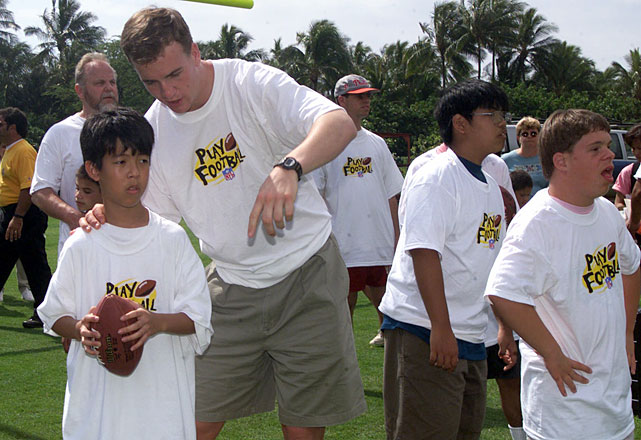 Manning gives passing instructions during a Pro Bowl Special Olympics Event. Manning has been named to 11 Pro Bowls during his career.