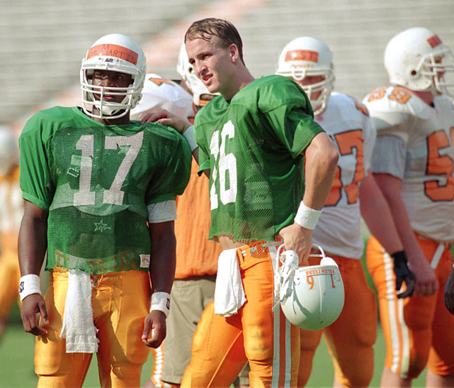 Peyton Manning gives some tips to backup quarterback Tee Martin during his Tennessee days. Manning turned the downtrodden Colts into a perennial Super Bowl contender during his days in Indy, leading the team to eight division championships and three AFC championship games.