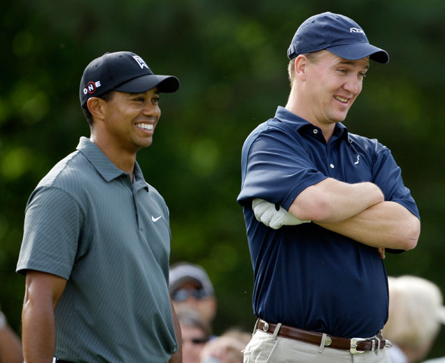 Peyton Manning shares a laugh with Tiger Woods in 2009. Manning will end his Colts career with nearly all of the franchise's passing records.