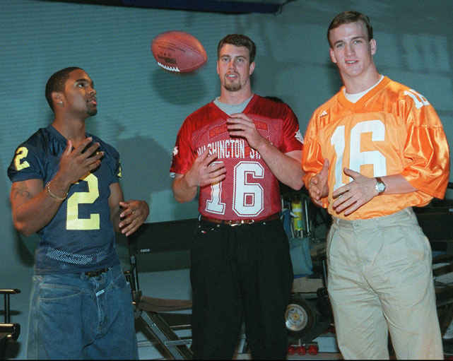 Manning, Charles Woodson (left) and Ryan Leaf (center) toss a ball around prior to the 1998 NFL draft. Manning, who controversially lost out on the 1997 Heisman Trophy to Woodson, was the first selection of the draft, with Leaf going second to the Chargers.