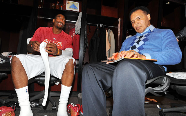 Muhammad Ali looks completely uninterested in whatever Amar'e was saying before the 2009 NBA All-Star Game in Phoenix.