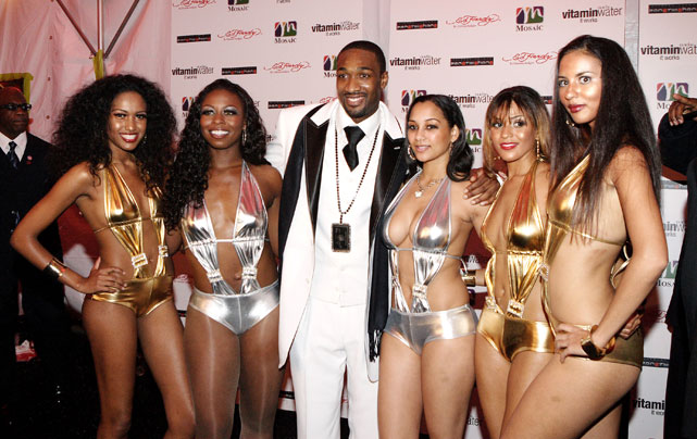 The most incredible thing in this lovely photo is not the five barely clothed models hanging onto Arenas at his 25th birthday party. No, the most incredible thing is his chain, which appears to be a diamond-encrusted black American Express card. He really is a baller.