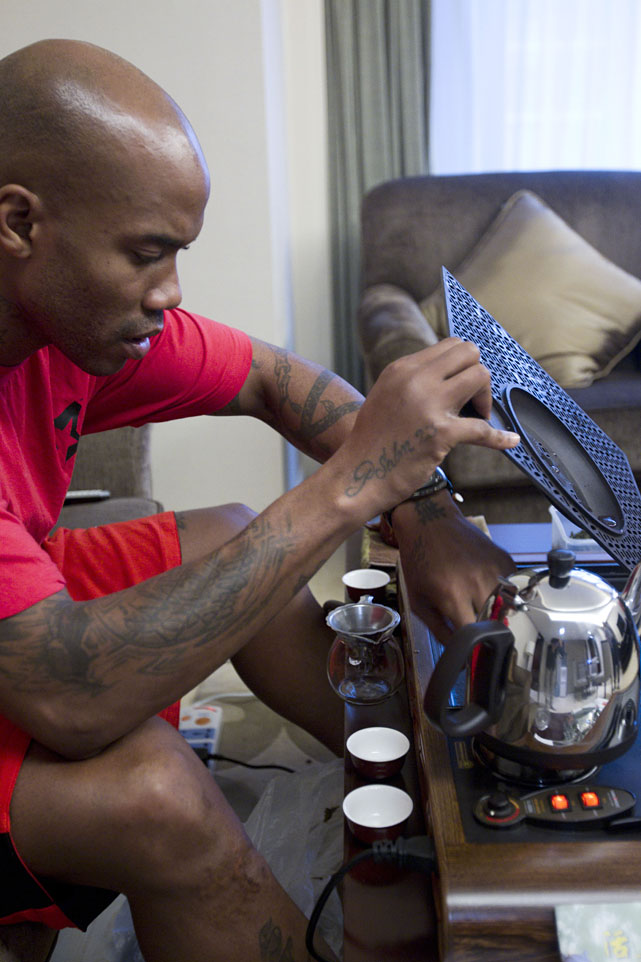 Marbury makes tea at home during a half-day holiday.