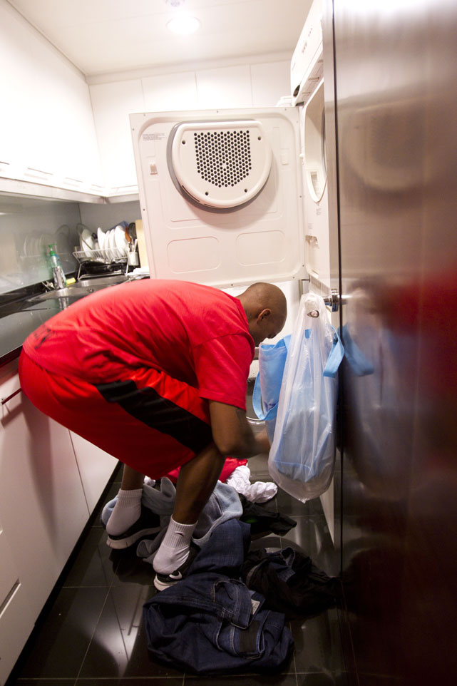 Marbury prepares to wash clothes at home during a half-day holiday.
