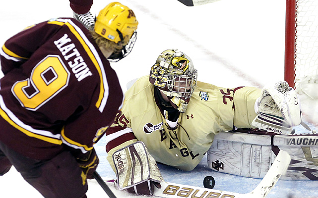 Boston College goalie Parker Milner makes a point-blank save on Minnesota's Taylor Matson in the first period of their national semifinal. Milner stopped 30-of-31 shots for the top-ranked Eagles.