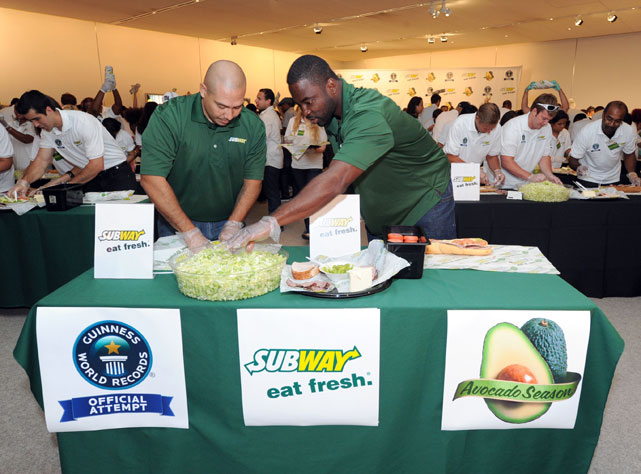 "On Wednesday, Giants DE Justin Tuck teamed up with SUBWAY, speed sandwich-maker Salvador Rodriguez and 248 other ""chefs"" to set a new Guinness Record for most sandwiches made at one time. In honor of Tuck and his crowning achievement, SI takes a look at athletes and sandwiches."