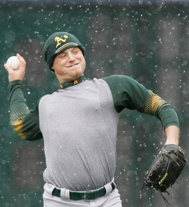 Athletics pitcher Chad Gaudin works out during snow flurries at Comerica Park before Game 3 of the 2006 between Oakland and Detroit.