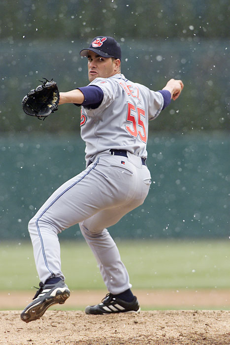 Cleveland's Danys Baez delivers a pitch during a snow flurry at the Tigers home opener at Comerica Park.
