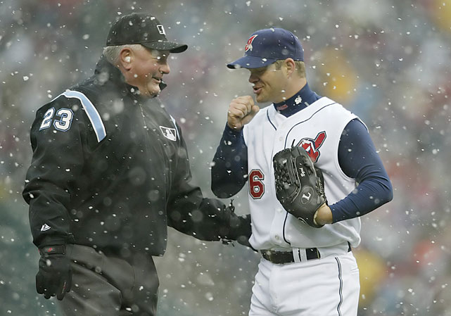 Indians pitcher Paul Byrd talks with umpire Rick Reed during a snow delay against the Mariners.