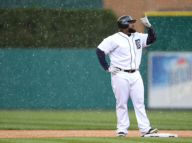 Tigers first baseman Prince Fielder points to snow falling after hitting a eighth inning RBI double against the Rays.
