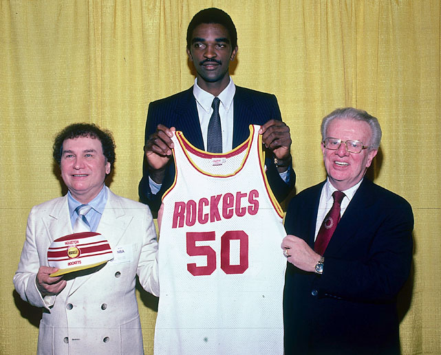 Sampson holds a Houston Rockets uniform after he was selected No. 1 overall during the 1983 NBA Draft.
