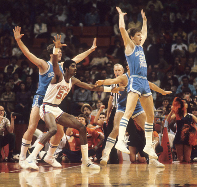 BYU guard Danny Ainge tries to block Sampson from receiving a post pass during a 1981 tournament game.