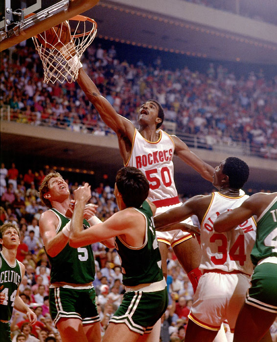 Sampson uses all of his 7-foot-4 frame to put back a rebound during a 1985 Celtics-Rockets game.