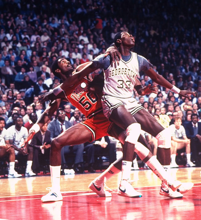 Sampson and Georgetown center Patrick Ewing battle for position in the paint.