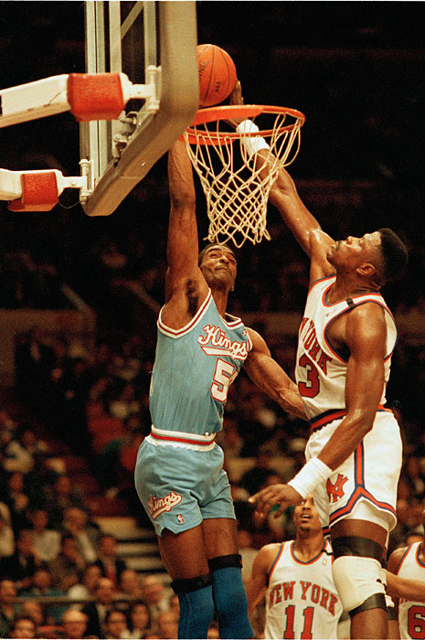 Sampson was traded to the Kings after the 1988-89 season. In this photo, Sampson is swatted by his old college nemesis Patrick Ewing.