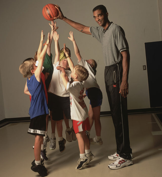 Sampson uses his length to keep the ball away from a group of children during a 2002 SI photo shoot.