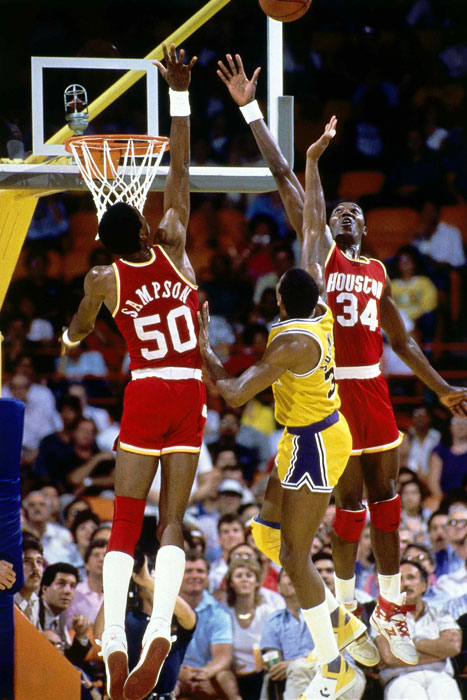 Sampson and Hakeem Olajuwon just miss blocking a shot by Magic Johnson during a 1984 Rockets-Lakers game.