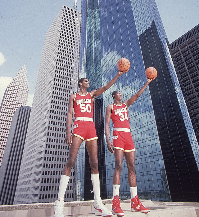 The Twin Towers --  Ralph Sampson and Hakeem Olajuwon -- pose in front of the real Twin Towers for a 1986 SI photo shoot.