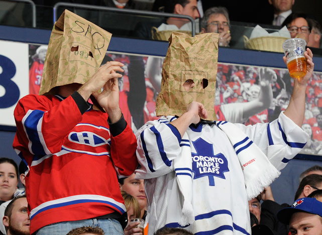Last week, a Maple Leafs fan and Canadiens fan attended a game at the Air Canada Center with paper bags draped over their heads. The two were expresing their disappointment in the team's poor performance this season. In honor of this duo (and disgruntled fans everywhere), here's a look at some other fans who felt the need to cover their face while attending a game.