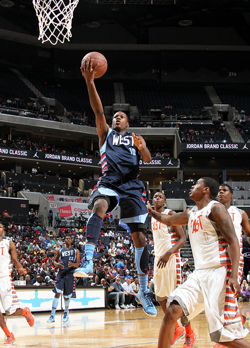 One of three Kentucky commits in action on Saturday, shooting guard Archie Goodwin flies past Ricardo Ledo. Goodwin filled up the stat sheet to the tune of 14 points, four rebounds, four assists and two steals.