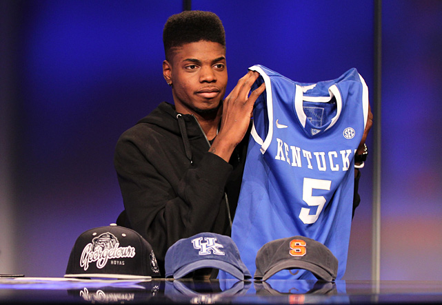 Noel hoists a Kentucky jersey to commemorate his decision, much to the delight of Wildcat fans everywhere.