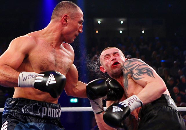 Germany's Arthur Abraham lays a punch on Poland's Piotr Wilczewski during their WBO super middleweight eliminator fight at Sparkassen Arena in Kiel, Germany.