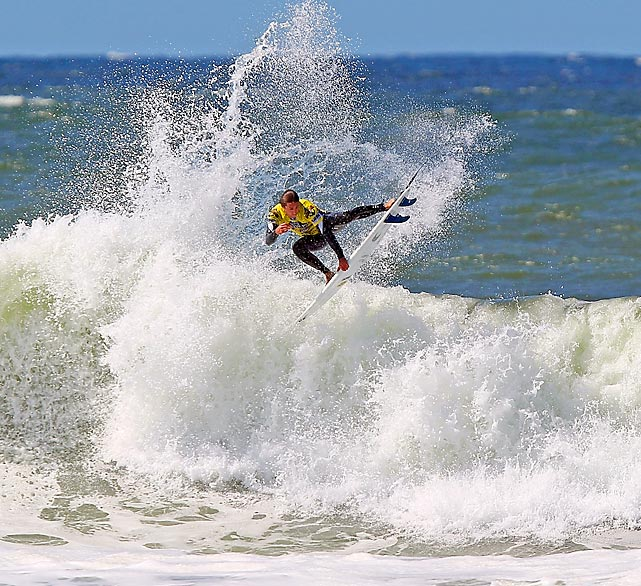 Asher Nolan of the U.S. conquers a wave in the Vans Pier Classic presented by Jack's Surfboards in Huntington Beach, Calif.