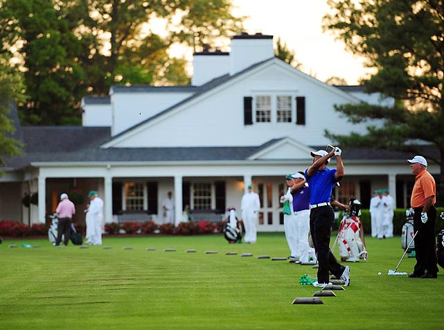 Tiger Woods, a favorite at the 2012 Masters tournament, takes a few practice swings at Augusta National Golf Club.