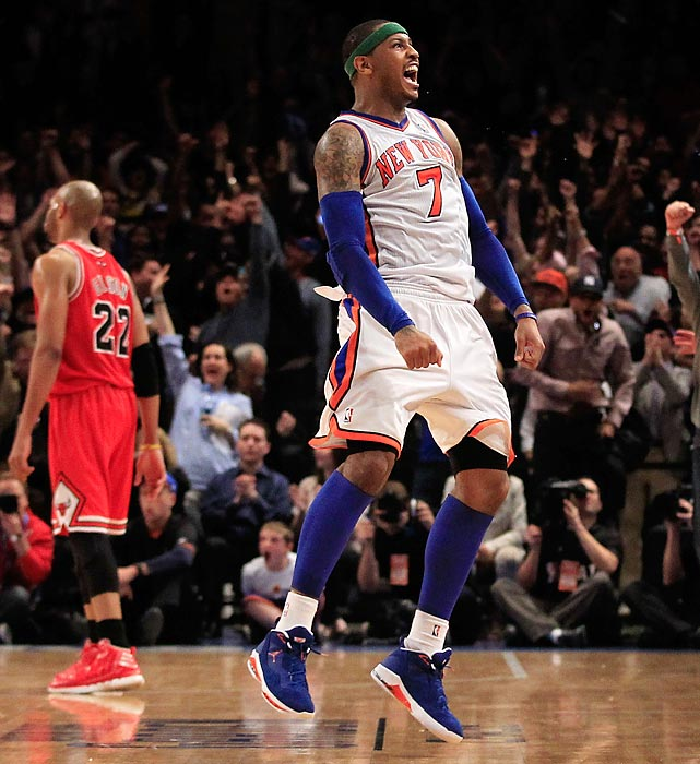 Knicks star Carmelo Anthony celebrates after shooting the game-tying three against the Bulls at Madison Square Garden. The Knicks would go on to win the matchup 100-99 in overtime.