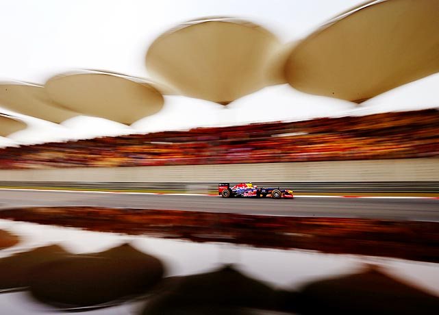 Australian Mark Webber of Red Bull Racing zooms by during qualifying rounds for the Chinese Formula 1 Grand Prix in Shanghai.