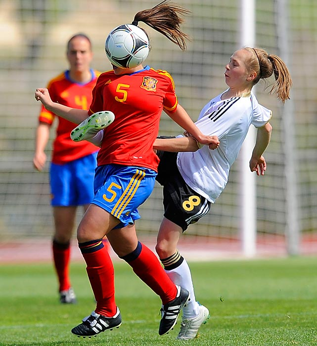 Spain's Carola Garcia gets a kick to the midsection during the Spain vs. Germany UEFA U17 European Championship match.
