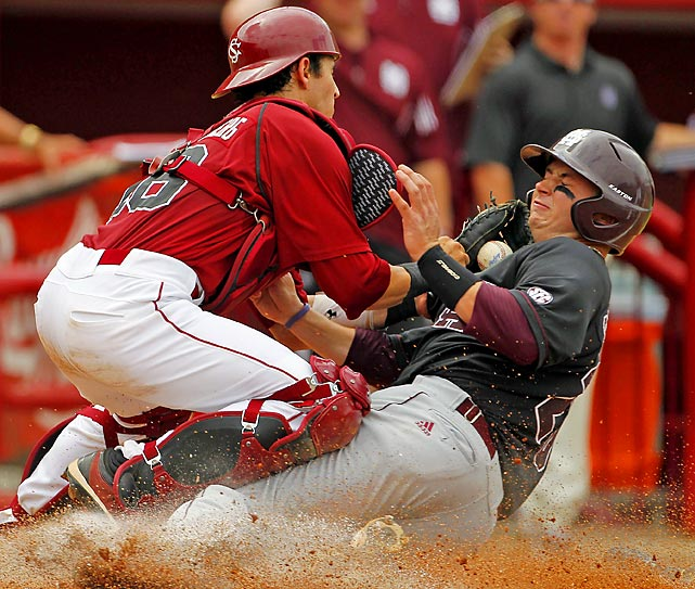 South Carolina catcher Dante Rosenberg collides in vain with Mississippi State's Mitch Slauter.