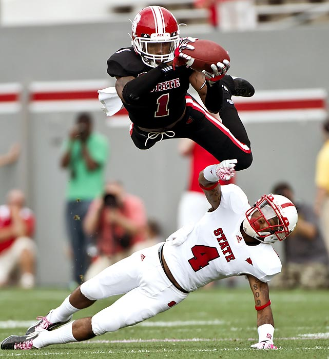N.C. State's David Amerson sails over teammate Tobais Palmer to intercept a ball during the Wolfpack's spring football game at Carter-Finley Stadium in Raleigh.