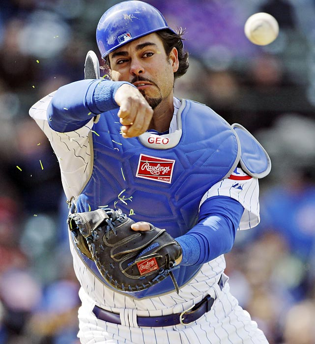 Chicago catcher Geovany Soto tosses to first base during the sixth inning of a Cubs' game against the Reds.