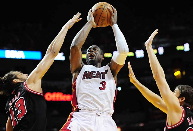 Dwayne Wade fends off Joakim Noah in the Heat's home matchup against the Chicago Bulls. Miami would go on to beat Chicago 83-72.