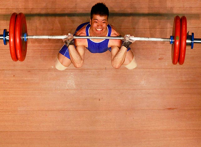 Zholamanov Yerbolat of Kazakhstan  competes in the 62kg weight class during the Asian Weighlifting Championships at Yichung Culture & Sports Center in South Korea.
