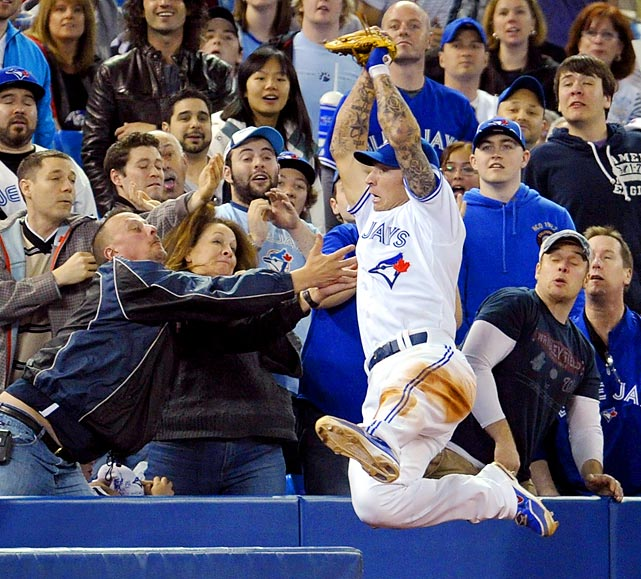 Blue Jays third baseman Brett Lawrie catches a foul ball hit by Seattle's Munenori Kawasaki during the ninth inning of Sunday's game. The Mariners would go on to win 7-2.