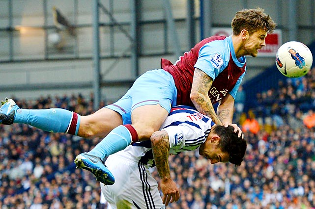 Ashton Villa midfielder Chris Herd sails over West Bromwich Albion's Liam Ridgwell during the English Premier League match at The Hawthorns in England.