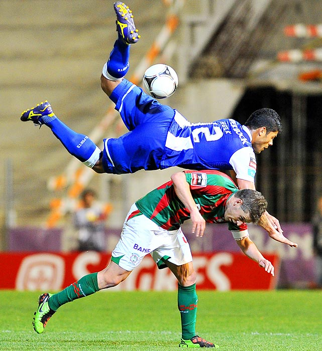 FC Porto's Hulk lands on top of Maritimo's Briguel during a Portuguese league match Saturday. Hulk would go on to score both goals in Porto's 2-0 win.
