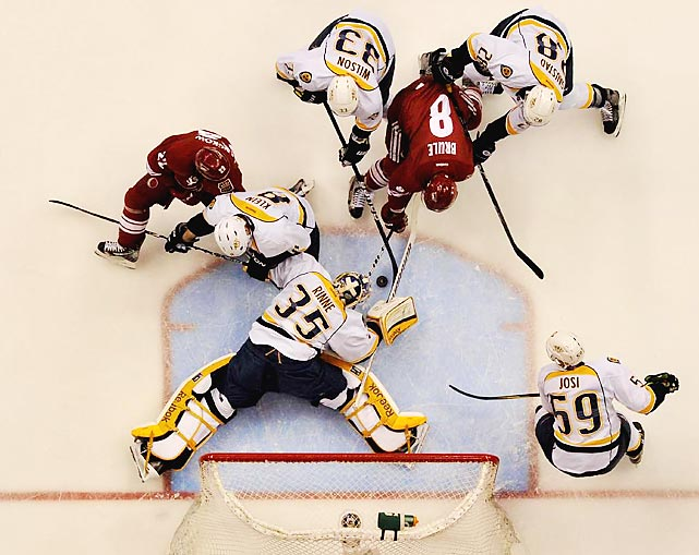 Predators goalie Pekka Rinne dives for a save during a Game 2 showdown with the Coyotes Sunday night. Phoenix won 5-3.