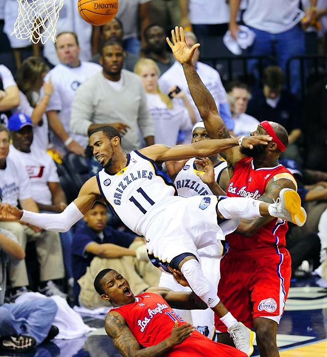 Grizzlies guard Mike Conley falls toward Clippers guard Eric Bledsoe during Sunday night's game at FedEx Forum in Memphis. The Clippers edged out the Grizzlies 99-98.