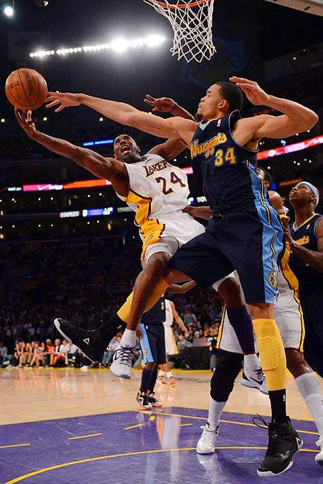 Kobe Bryant gets denied by Nuggets center JaVale McGee during Sunday's Denver-Los Angeles Staples Center showdown. The Lakers won 103-88.