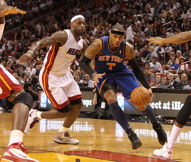 Anthony, who was traded to the Knicks in Feb. 2011, drives past James during a 2011 Heat-Knicks game. James had joined the Heat during the summer.