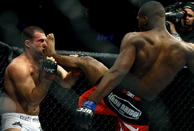 Jones, 23, scores a technical knockout of Rua to become the youngest UFC world champion in history.