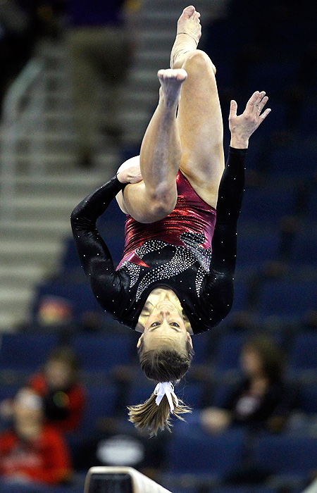 Stanford's Nicole Pechanec flips on the balance beam during the team semifinals. The Cardinal finished fourth overall in the team competition.