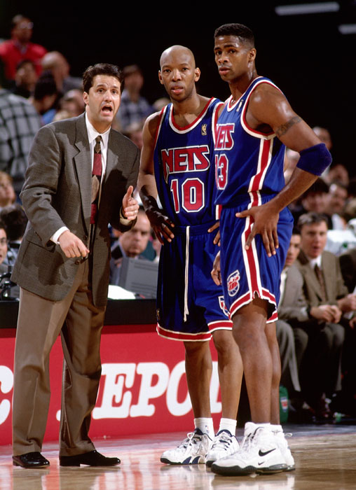 Sam Cassell and Kendall Gill talk with John Calipari during a 1997 game against the Trail Blazers.