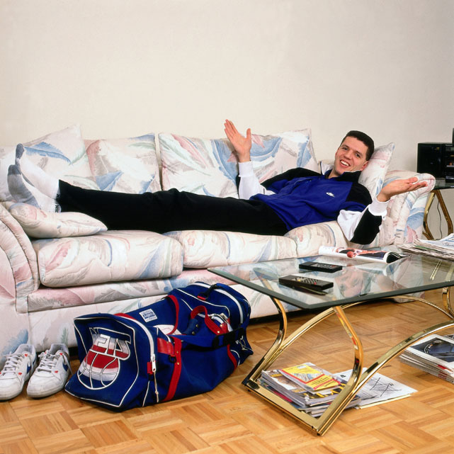 Drazen Petrovic lays on the couch during a 1991 photo shoot. Petrovic was one of the first Europeans to become an NBA star, though his life was tragically cut short in a 1993 car accident.
