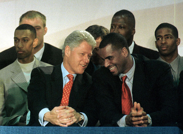 President Bill Clintonand Jayson Williams joke around while addressing students and faculty at Malcolm X Shabazz High School in Newark, N.J. Other Nets players in the background include Kerry Kittles (far left) and Kendall Gill (far right).